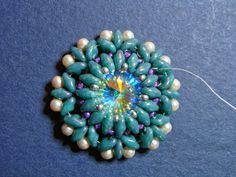 Beaded Girl: An Easy Way to Bezel a Rivoli with Superduos.  #Seed #Bead #Tutorials