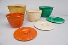 Vintage fiesta ware nesting bowls with lids.