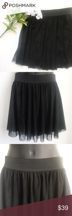 Stradivarius Black Tulle Mini Skirt • Layers of Tulle • Lined • Glitter Elastic Waist • Mini Style Skirt • Stretchy  Size: Medium Color: Black Condition: Like New Condition Material: Tag is Missing *Stock photo shown for fit and style*  Measurements Length: 18 inches Waist: 12.5 inches All measurements are approximate.  No stains, rips, tears | Pet/Smoke free home. Offers welcomed ✨ Stradivarius Skirts Mini
