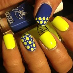 Neon blue and yellow nail art design. Simple and very easy to recreate, you can design the polka dots on your nails in any way that you want; random or in diagonal position. The matte yellow polish on the other nails help give more emphasis on the polka dot designs.