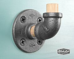 Fancy Each wall hook is handcrafted from black iron pipe fittings and oak wood The wood