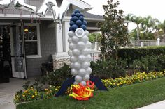 Rocket ship/ outer space made out of balloons! CUTE for Blast Off VBS decoration.