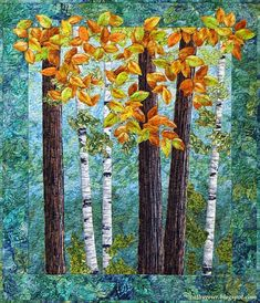 Simple landscape quilt with tree trunks and leaves. Raw edge applique.