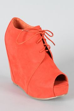 Peep Toe Lace Up Wedge Bootiessssss. I want.