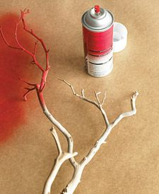 Make a visual statement and take up extra shelving space with spray painted manzanita branches. -great for an entertaining table as well.