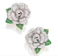 Designed as gardenias pavé-set with round diamonds weighing approximately 15.50 carats, with leaves accented by calibré-cut emeralds weighing approximately 6.75 carats