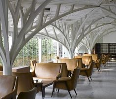 leather chairs and trees... Interesting architectural elements going on here!