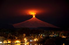 The Villarrica Volcano is seen at night from Pucon town, Chile, July 12, 2015. Villarrica, located near the popular tourist resort of Pucon, is among the most active volcanoes in South America. REUTERS/Cristobal Saavedra