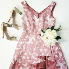 Sheena Dress. A stunning cocktail dress by Lounge. A v-neck style featuring a pink floral print and ruffle skirt.