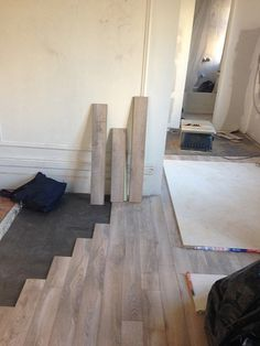 wood laminate flooring being installed in small New York city kitchen and living room.- great color