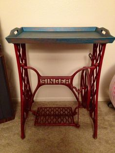 Vintage end table: antique sewing machine base plus serving tray top.
