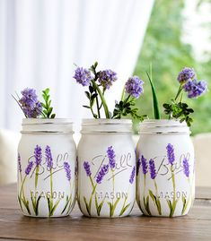 Set of three pint-sized mason jars hand painted and distressed in lavender flowers. Perfect gift idea for Mothers Day or weddings. Great for centerpieces at events, like weddings, baby showers, birthday parties. The insides of the jars are not painted, so it's okay to put water in them. The exteriors have been sprayed with a matte enamel protective coat. Do not submerge in water or put in dishwasher. You can gently wipe them down with a damp cloth. Regular mouth pint jar size. Lids & ba...