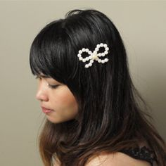 Follow this easy DIY tutorial to make a pearl bow barrette or headband. Just a few supplies needed.