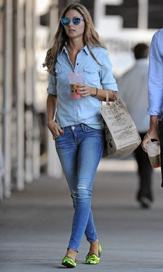 Olivia Palermo in Pretty Loafers out and about in New York | skinny jeans with a loose-fit 7 For All Mankind denim shirt. Neon camouflage flats by Pretty Loafers