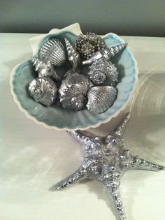 So easy to make real sea shells look like expensive pewter art pieces. Just lay your shells out on a piece of cardboard and spray paint them with a high gloss silver enamel. Dry overnight and display. They also look great if you display them with shells left natural!