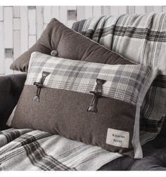Tartan cushion with leather detail from feather my nest interiors