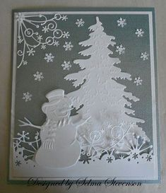 """Marianne Design tree.  The snowman is the new snowman from Marianne Design  .  The snow border along the bottom of the card is the Memory Box """"Frostyville Border"""" and the corner die is the Memory Box """"Snowflake Corner"""". I saved the snowflakes from the Martha Stewart """"Aspen Snowflake"""" border punch for additional snow."""