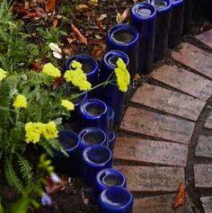 Bottle Garden Edging For some decorative recycling, consider burying old bottles upside down to create edging for your garden beds and walkways. This example uses only cobalt blue glass, but bottles of any color would look just as striking.  Bottle Garden Edging - Wine Bottle Crafts - 10 New Uses for Old Bottles - Bob Vila