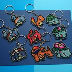 Finally finished making them double sided and attaching the Keychains. All 9 now… Pokemon Cross Stitch, Tiny Cross Stitch, Pokemon Perler Beads, Diy Perler Beads, Cross Stitching, Cross Stitch Embroidery, Cross Stitch Patterns, Bracelet Patterns, Beading Patterns