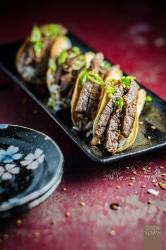 Might not be traditional, but its a fusion dish I would have in a heartbeat - Beef Teriyaki Tacos!
