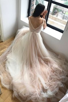 Meet a gown that's as light as air and incredibly fun to twirl in! DAWN wedding dress by Kelly Faetanini features layers of blush tulle and a sexy V-neckline (Shown in Blush, also available in Ivory) // V neck ball gown with ombre pleated bodice and skirt. @kellyfaetanini #KellyFaetanini #weddingdress #weddinggown #sponsored #wedding #bridal #blush #weddingdresses #romantic #ombre