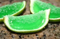 Margarita Jello Shots  2 tequila mini's and half a bottle of the orange liquor mini (the total amount of liquor was half a cup) I mixed it together and set the bowl aside.  Pour your jello into the lime shells  Cut the lime into wedges (you can add salt just be sure to add the salt as you are serving them because it dissolves quickly on top of the jello)