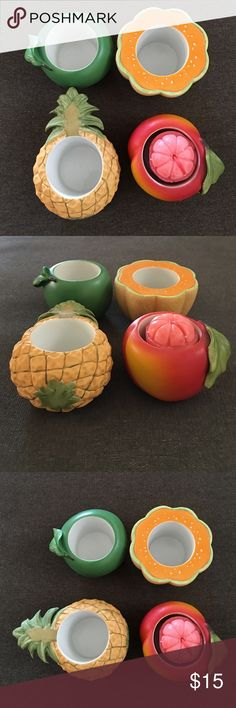 Set of 4 fruit tea candle holders Set of 4 Mini fruit tea candle holders, porcelain ceramic, cute pineapple, cantaloupe, peach and apple. Still new, no chips or damages. Holds small tea candle. Other