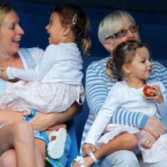 This has got to be one of the cutest pics of the little Federer girls! The little one laughing is just adorable!!