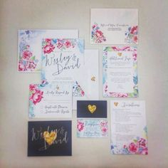 Remember that #sneakpeek we gave you a few weeks ago for #weddingwednesday? Well today we're sharing the finished set! These gorgeous watercolor flora invites are fun vivid and oh-so-fashionable right now! We especially love the pops of navy and gold! #watercolorwedding #prettyflowers #hellobeautiful