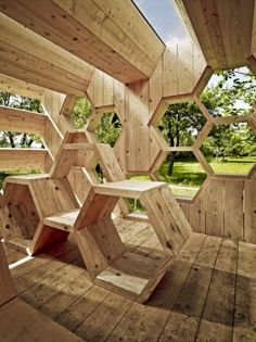 K-abeilles Hotel for Bees,  Muttersholtz, France, by: atelierd.org.  A hotel for bees, the outside faces of the structure are hexagonal compartments providing a variety of nesting materials. These small shelters provide habitat for endangered wild bees, while the interior provides seating and a covered area for people.