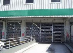 Sales & Installation Quote on Warehouse Indtusrial & commercial door security, access control, and galvanized folding scissor security gates.