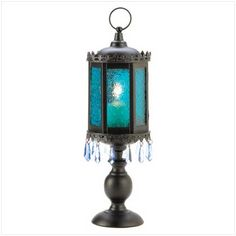 The blue of the desert sky brings brightness to the night, lending splendor to even the quietest evening. Sturdy standing candle cage is the perfect mix of artistic and exotic!