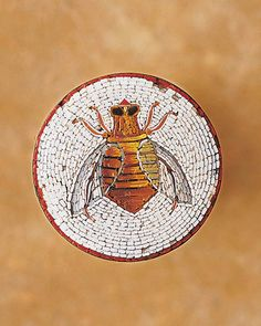 Symbolic of industriousness and harmony, bees are the perfect motif to decorate humble domestic objects, especially those for the kitchen, the bustling hive of a home. These are not rare, special-occasion-only pieces, but commonplace treasures, including pitchers, plates, and even pincushions and coin banks. They're charming and versatile -- a ceramic honey pot can be filled with candy, a glass honey jar with a single daisy -- and evoke thoughts of summertime, no matter the season.