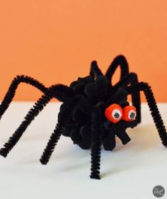 Pinecone Spiders | Get the kids involved with decorating the house for Halloween. Or use these ideas as an activity if you're throwing a seasonal party.