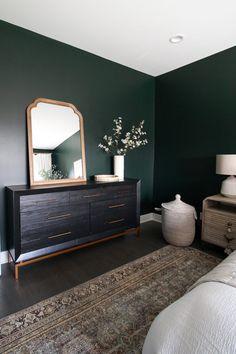 Contemporary Condo in Chicago dark green guest room reveal. Come check out this dark green paint color, with a large oriental rug, white bedding, and creamy curtains. Green Bedroom Walls, Green Master Bedroom, Green Accent Walls, Home Bedroom, Dark Green Walls, Wall Mirrors In Bedroom, Bedroom Black, Gray Walls, Master Bedroom Color Ideas