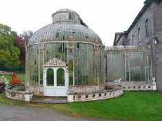 Original early Victorian glass conservatory attached to a big Georgian country house in England