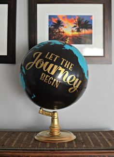 Blogger Kendra painted over a thrift-store globe to match the colors of her nursery, then hand-painted this (appropriate!) phrase on the dried product.