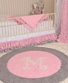 Pink and gray nursery design - love the personalized rug!