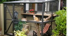 These 5 Cats Outside Catios Are Brilliant+Free DIY Plans!! - http://www.lovedcats.com/5-cats-outside-catios/-http://www.lovedcats.com/wp-content/uploads/sites/254/2015/07/Catios.cat-outoor-house.feature-sizejpg-1024x559.jpg -These 5 Cats Outside Catios Are Brilliant! These Cat Catios have me so pumped up to make one and keep my 2 rascalls totally Safe,the designs are brilliant! There is a style for any house or apartment too,even with no yard,you can get a place for puss to