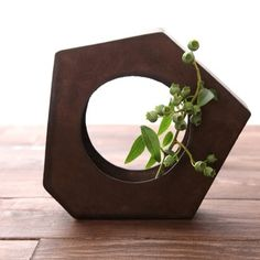 Keiichi Tanaka. I love the geometric and earthy simplicity of this. I'm thinking about finding some interesting iron pieces like this (scrap pile) and planting some little clover shoots inside.