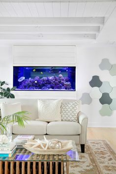 The DIY Network Blog Cabin 2016 living room showcases serene coastal colors, relaxing water views and a fireplace focal point refinished with tile. >> http://www.diynetwork.com/blog-cabin/2016/living-room-pictures-from-diy-network-blog-cabin-2016-pictures?soc=pinterest