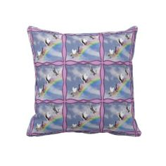 3 cats running on the rainbow getting halos and wings. This pretty scene is in a repeated tile pattern on this pillow.