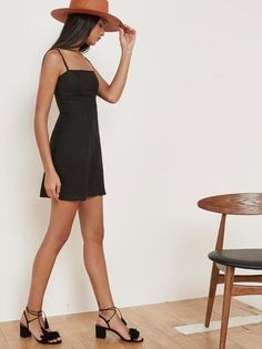 Fresh linens. This is a fit and flare, mini dress with a straight neckline and adjustable straps.
