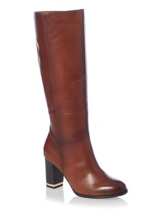 This Tu footwear is stylishly designed to be flexible, lightweight with extra padded insoles, because we know comfort is essential. Our Tu leather products are crafted from the most premium materials, offering you the ultimate style and quality. Tan long leather heeled boot Leather Zip fastening Metallic heel detail Long length
