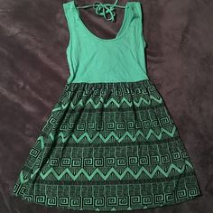 Mint Green Tribal print sleeveless dress NWT. Mint green tribal sleeveless dress. Bought from a little Texas boutique online. Cute tie back detail. Reaches about mid thigh. Skirt 18 inches long. Top part is a stretchy cotton material. Size large, but could fit medium no problem Dresses Mini