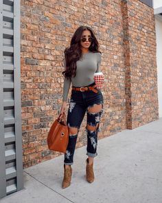 033587576993a Yvetteg23 on Instagram olive green bodysuit tan belt distressed jeans  outfit brown tan booties street style