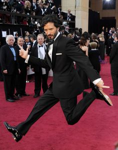 Bret McKenzie, of Flight of the Concords, strikes a pose at the Oscars.