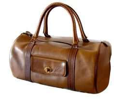 Bonnie Cashin for Coach Saddle Leather Safari Bag Duffle Tote Carry On 1960s    From a collection of rare vintage luggage and travel bags at https://www.1stdibs.com/fashion/handbags-purses-bags/luggage-travel-bags/