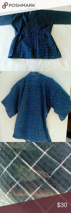"Authentic Kimono / Yukata Style Robe NWT!! This lovely robe is called a Yukata which is a casual style Kimono! This is considered a summer robe and is unlined and is I believe a sheer type cotton. Yukata are mostly worn by women. Yukata wearing dates back to over 1000 years and became very popular during the Edo period. Measuring 47"" across sleeves and shoulder. 32"" length and 18"" (36"") waist when tied tight.  There is a left front pocket. Very well made in my opinion. Navy blue with white…"