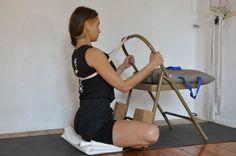 Baddha Konasana using a chair, blocks and a strap to lift the chest.